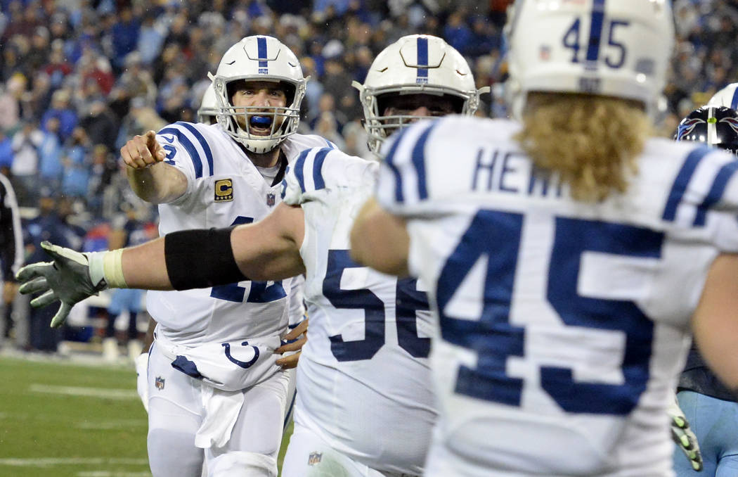 Indianapolis Colts quarterback Andrew Luck, left, runs to celebrate with tight end Ryan Hewitt (45) after they teamed up on a 1-yard touchdown pass against the Tennessee Titans in the second half ...