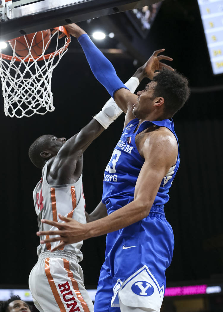 Brigham Young Cougars forward Yoeli Childs (23) dunks on UNLV Rebels forward Cheikh Mbacke Diong (34) during the second half of an NCAA college basketball game at T-Mobile Arena in Las Vegas on Sa ...