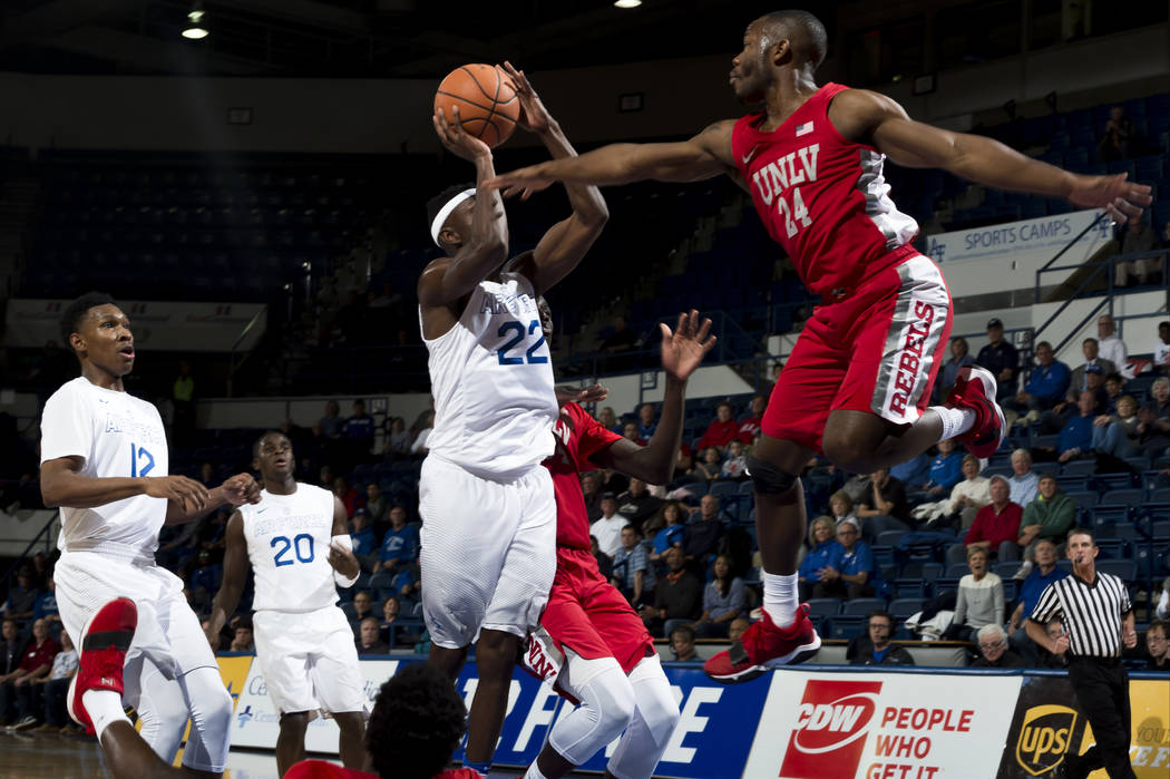 Air Force guard Pervis Louder (22) goes for a basket as UNLV guard Jordan Johnson (24) defends during an NCAA college basketball game at Air Force Academy, Colo., Wednesday, Jan. 10, 2018. (Dougal ...