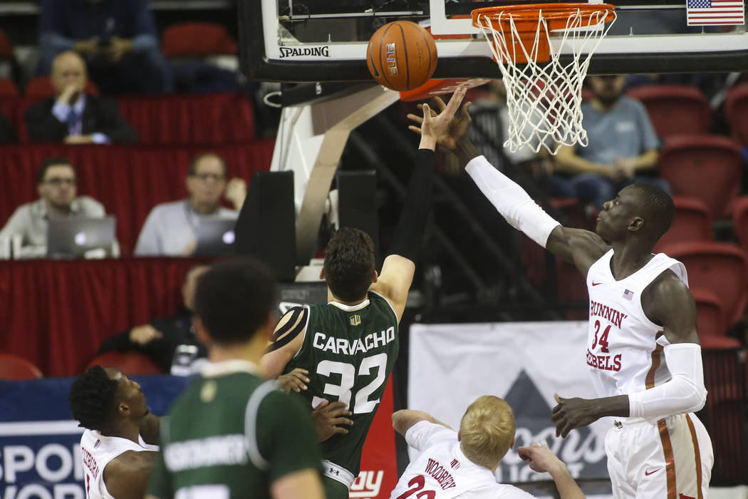 UNLV Rebels forward Cheikh Mbacke Diong (34) goes for a rebound against Colorado State forward/center Nico Carvacho (32) during the second half of a basketball game at the Thomas & Mack Center ...