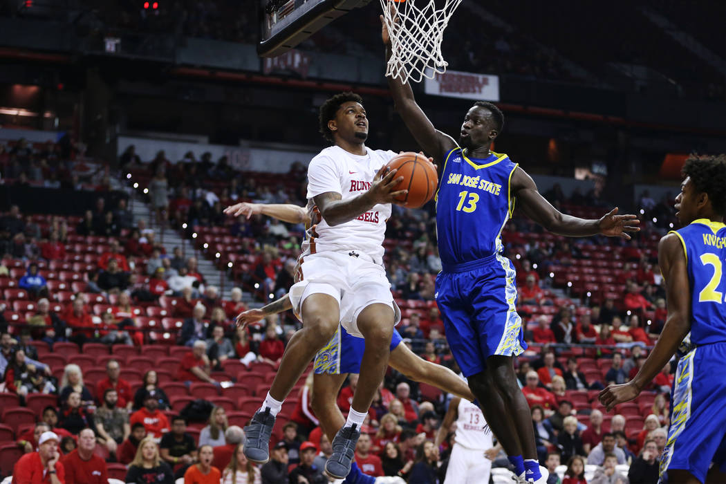 UNLV Rebels forward Tervell Beck (14) goes up for a shot under pressure from San Jose State Spartans center Oumar Barry (13) in the first half of the basketball game at the Thomas & Mack Cente ...
