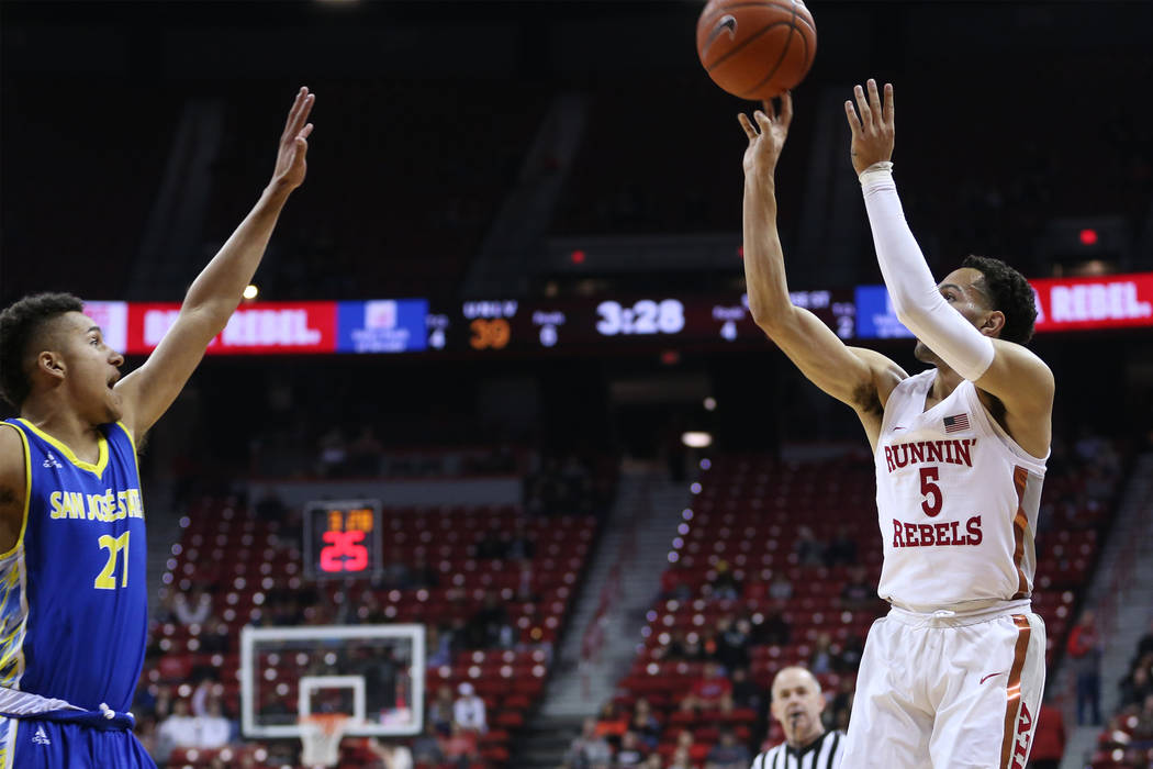 UNLV Rebels guard Noah Robotham (5) takes a shot under pressure from San Jose State Spartans guard Kaison Hammonds (21) in the first half of the basketball game at the Thomas & Mack Center in ...
