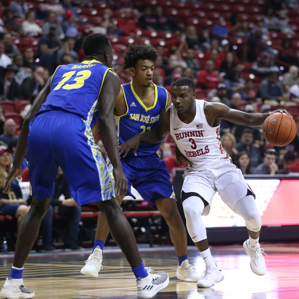 UNLV Rebels guard Amauri Hardy (3) looks to make a play under pressure from San Jose State Spartans guard Seneca Knight (23) in the first half of the basketball game at the Thomas & Mack Cente ...