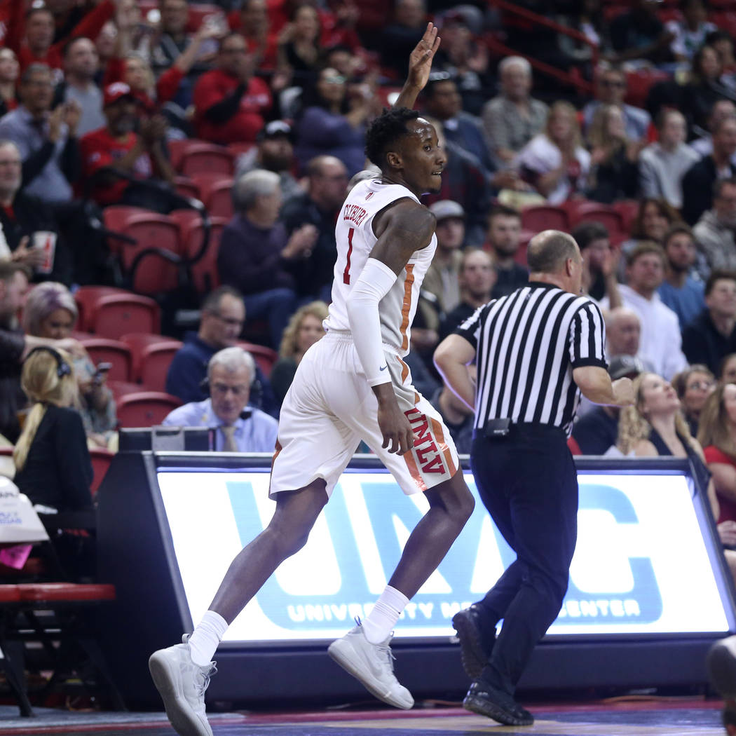 UNLV Rebels guard Kris Clyburn (1) reacts after making a three-point-shot against the San Jose State Spartans in the first half of the basketball game at the Thomas & Mack Center in Las Vegas, ...