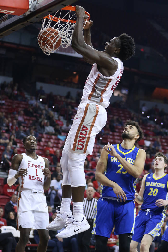 UNLV Rebels forward Jonathan Tchamwa Tchatchoua (30) dunks the ball against the San Jose State Spartans in the first half of the basketball game at the Thomas & Mack Center in Las Vegas, Satur ...