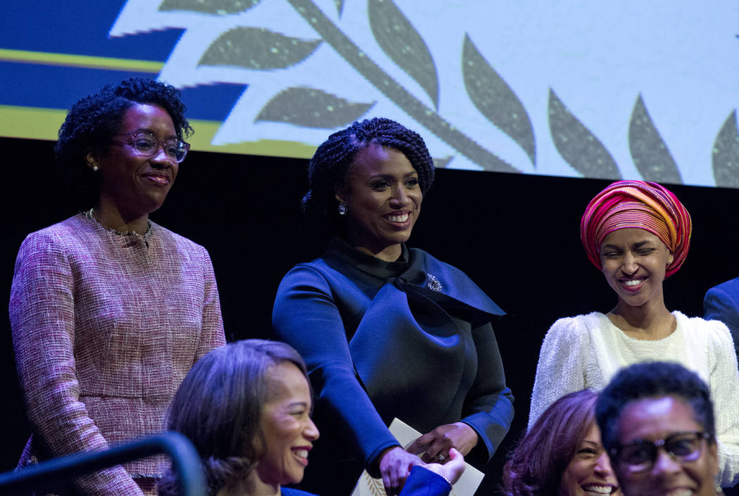 From left, Lauren Underwood D-IL, Ayanna Pressley, D-Mass., and Ilhan Omar D-MN, during the swearing-in ceremony of Congressional Black Caucus members of the 116th Congress at The Warner Theatre i ...
