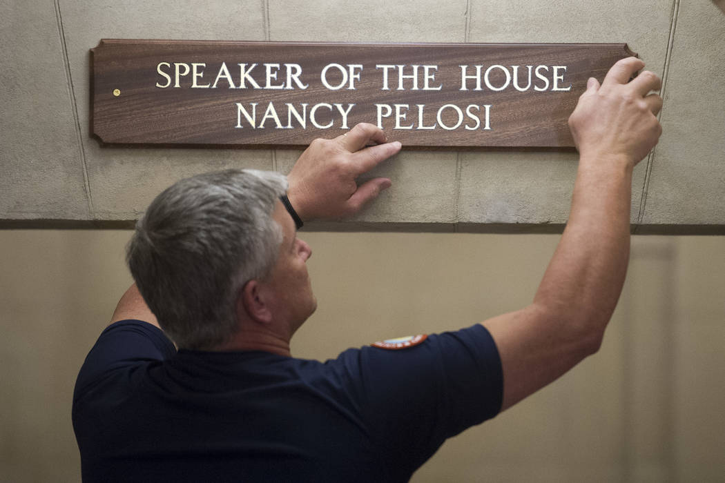 The sign at the office suite of House Speaker Nancy Pelosi of Calif., is installed on Capitol Hill in Washington, Thursday, Jan. 3, 2019, during the opening session of the 116th Congress. (AP Phot ...