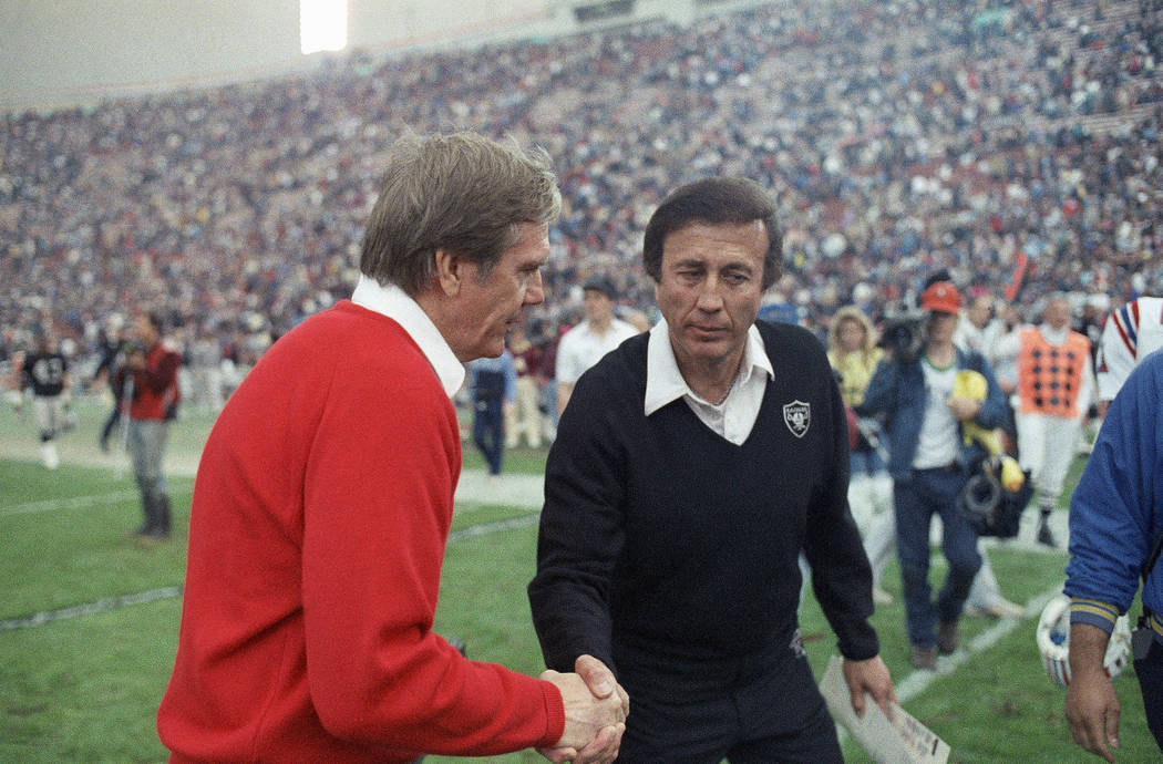 New England Patriots coach Raymond Berry, left, shakes hands with Los Angeles Raiders coach Tom Flores, Jan. 6, 1986 in Los Angeles. The Raiders lost the AFC playoff game 27-20. (AP Photo)