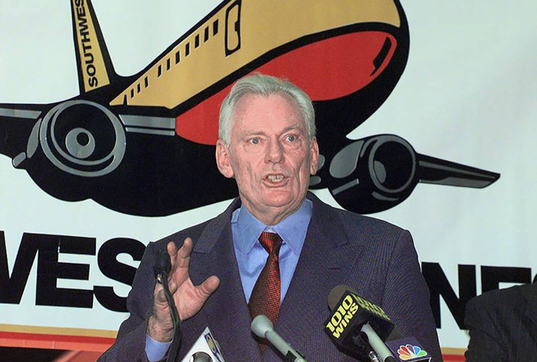 In this Dec. 9, 1998, file photo, Southwest Airlines President and CEO Herb Kelleher speaks at a news conference at MacArthur Airport in Islip, N.Y. (AP Photo/Ed Betz, File)