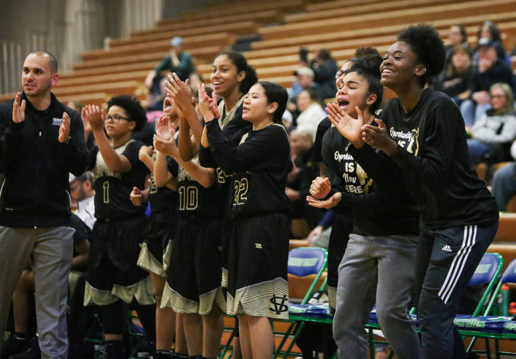 Spring Valley players on the sidelines cheer for their teammates during the second half of a basketball game at Green Valley High School in Henderson, Thursday, Jan. 3, 2019. Caroline Brehman/Las ...