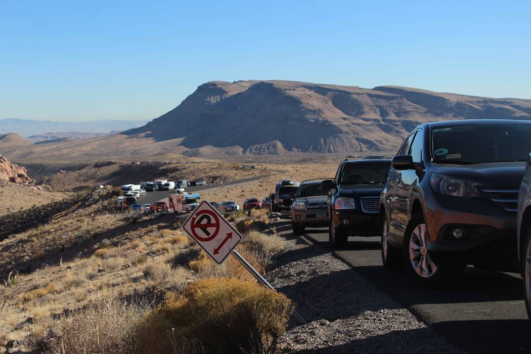 Cars line the side of the scenic loop at Red Rock Canyon National Conservation Area on Thursday, Jan. 3, 2019. (Max Michor/Las Vegas Review-Journal)