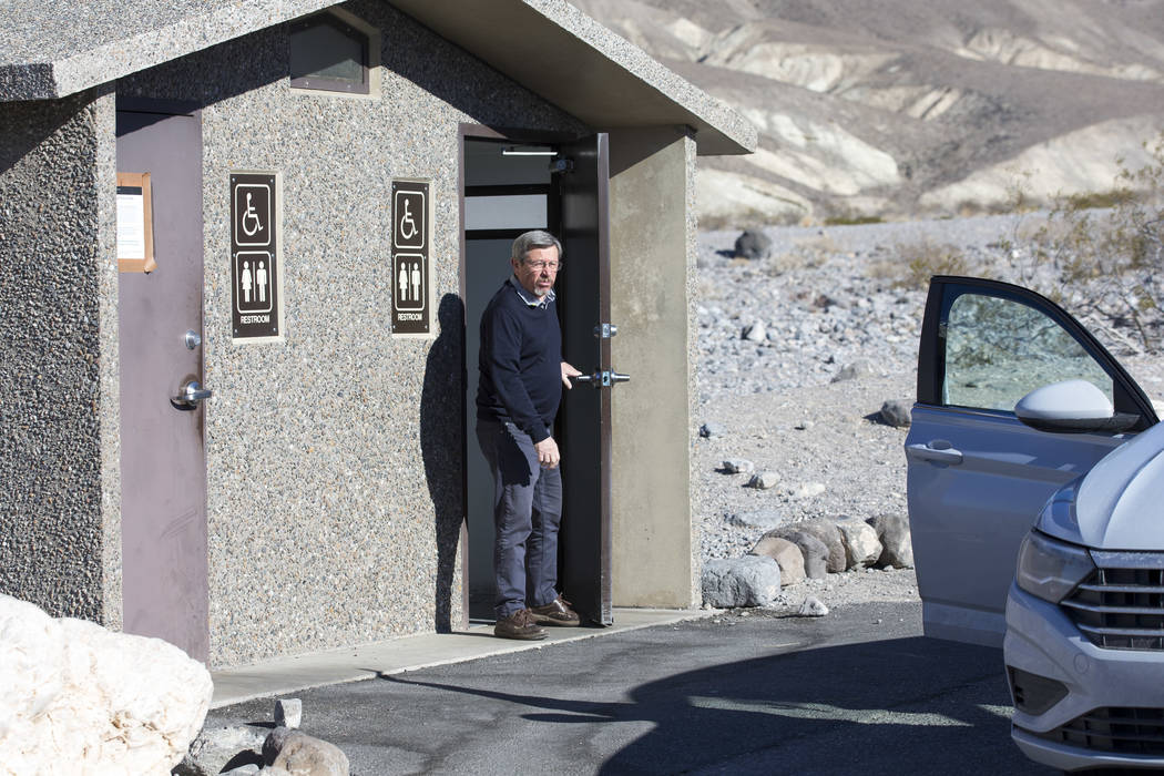 Jean-Claude Lefebure of Belgium exits a restroom along State Route 190 at Death Valley National Park in Calif., on Friday, Jan. 4, 2019. Several restrooms near the east entrance of the park remain ...