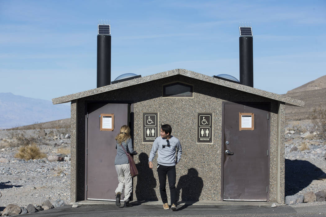 Visitors use a restroom along State Route 190 at Death Valley National Park in Calif., on Friday, Jan. 4, 2019. Several restrooms near the east entrance of the park remained open and maintained un ...