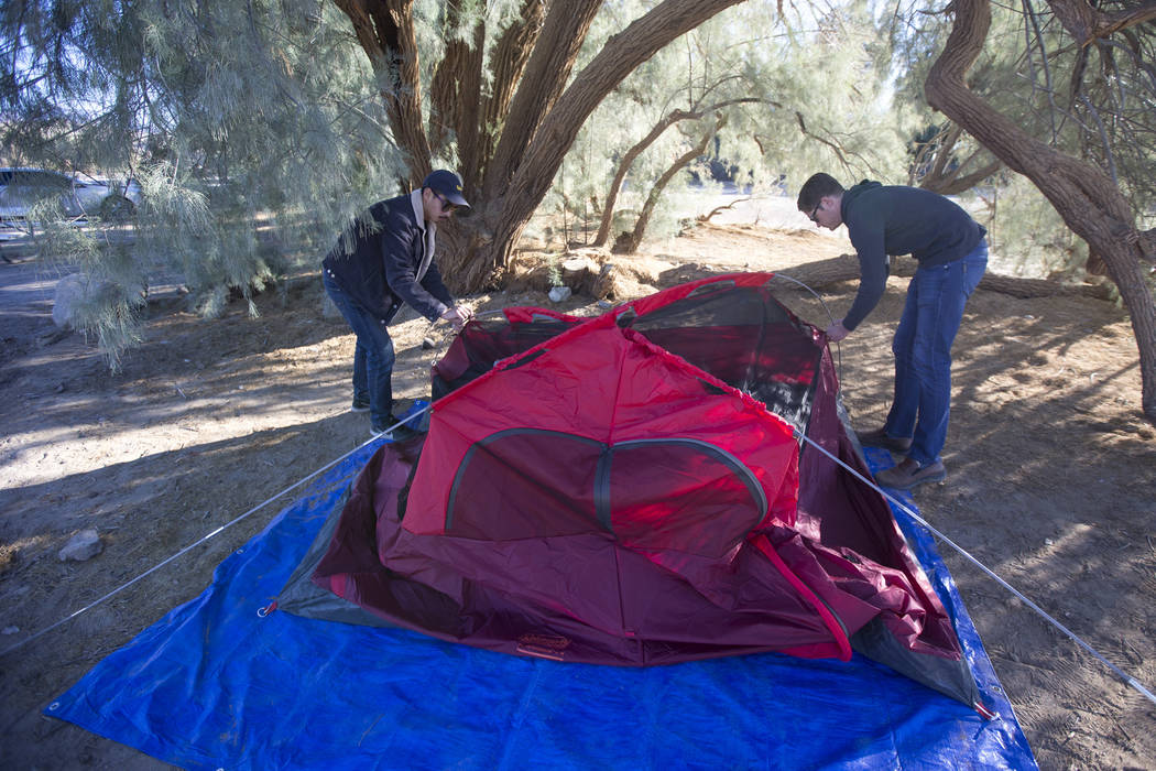 Oscar Arroyo, left, and Kevin Randolph, a couple from Los Angeles, pack up their campsite at the Furnace Creek Campground after campers at the site were forced to move following health and safety ...