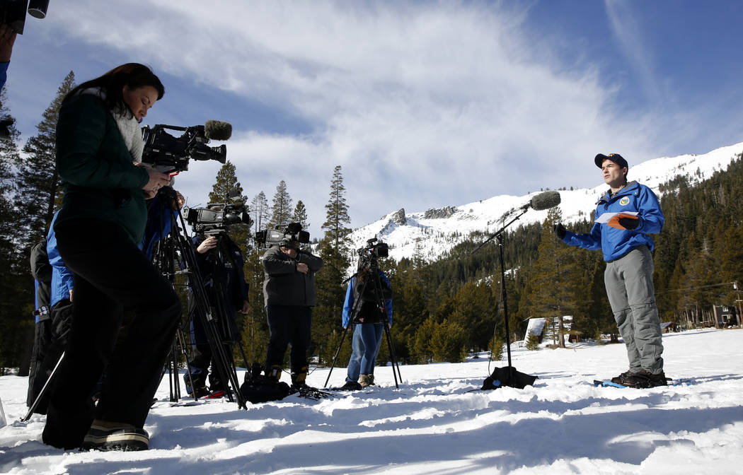 Department of Water Resources Water Resource Engineer John King, right, answers reporters questions after conducting the first snow survey of the season at Phillips Station, Thursday, Jan. 3, 2019 ...