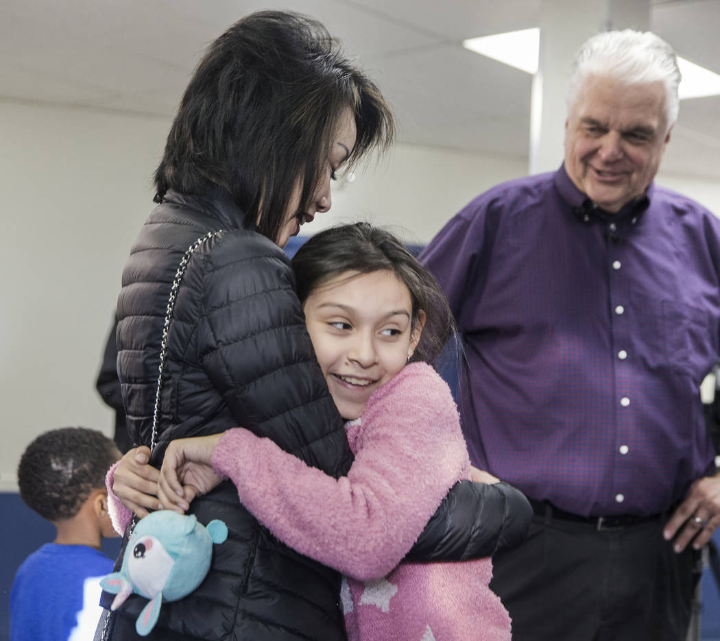 Karyme Hernandez, 11, hugs Kathy Sisolak during a visit to the Boys & Girls Clubs of Southern Nevada with her husband governor-elect Steve Sisolak on Thursday, Jan. 3, 2019, in Las Vegas. Benj ...