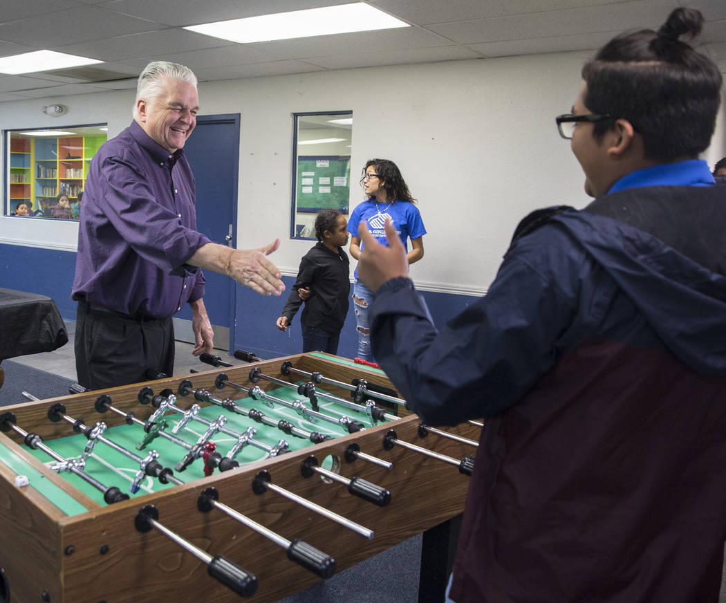 Governor-elect Steve Sisolak, left, shakes hands with Boys & Girls Clubs ambassador Jose De Dios after playing a game of foosball during a visit to the Boys & Girls Clubs of Southern Nevad ...