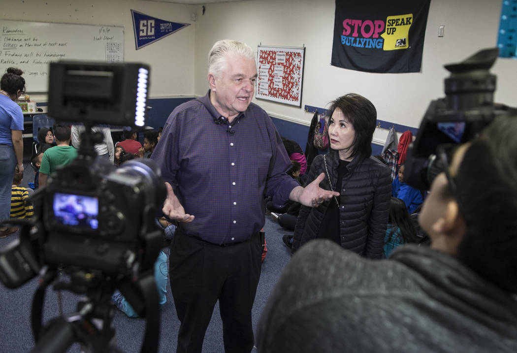 Governor-elect Steve Sisolak, left, and wife Kathy Sisolak take questions from the media during a visit to the Boys & Girls Clubs of Southern Nevada on Thursday, Jan. 3, 2019, in Las Vegas. Be ...