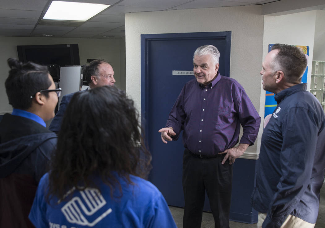 Governor-elect Steve Sisolak, middle, talks with Boys & Girls Clubs CEO Andy Bischel, right, and team ambassadors during a visit to the Boys & Girls Clubs of Southern Nevada on Thursday, J ...