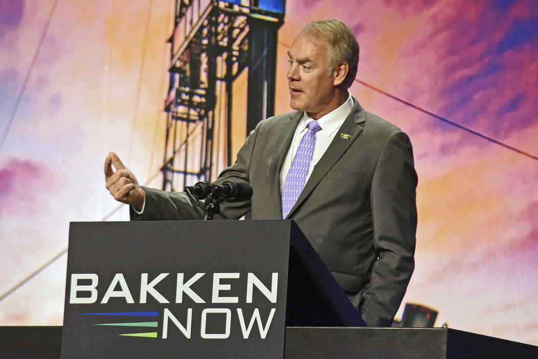 In this May 23, 2018, file photo, then U.S. Interior Secretary Ryan Zinke speaks at the Williston Basin Petroleum Conference in the Bismarck Event Center in Bismarck, N.D. As former U.S. Interior ...