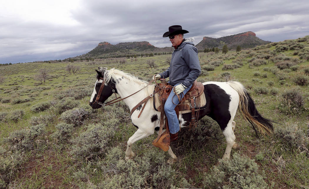 In this May 9, 2017, file photo, then Interior Secretary Ryan Zinke rides a horse in the new Bears Ears National Monument near Blanding, Utah. As former U.S. Interior Secretary Zinke exits Washing ...