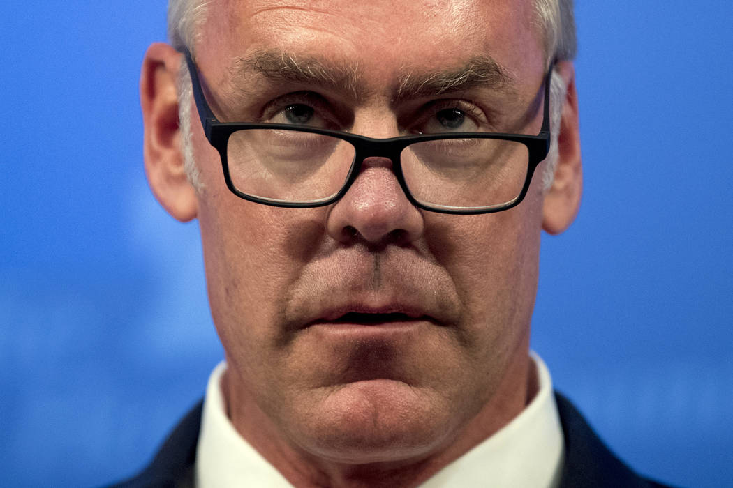 In this Sept. 29, 2017 file photo, then Interior Secretary Ryan Zinke speaks on the Trump Administration's energy policy at the Heritage Foundation in Washington. As former U.S. Interior Secretary ...