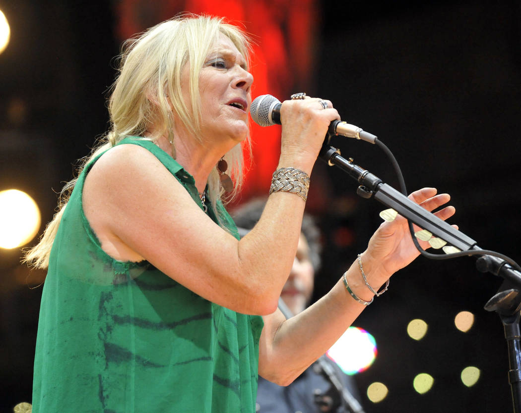 Pegi Young & The Survivors perform with Neil Young during the Farm Aid 2013 concert at Saratoga Performing Arts Center in Saratoga Springs, N.Y. on Sept. 21, 2013. (AP Photo/Hans Pennink, File)