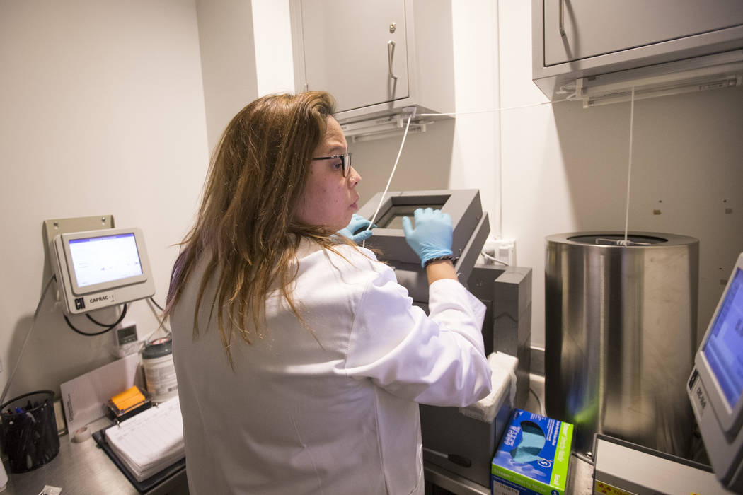 Nuclear Medicine Technologists Vanessa Martinez prepares a dose of the GE 180 radiopharmaceutical, a drug containing radioactivity, at the Cleveland Clinic - Lou Ruvo Center for Brain Health in do ...
