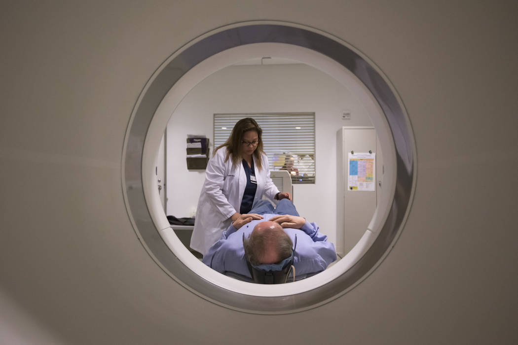 Nuclear Medicine Technologists Vanessa Martinez prepares to conduct the GE 180 scan on Las Vegas resident Jim Pettis at the Cleveland Clinic - Lou Ruvo Center for Brain Health in downtown Las Vega ...