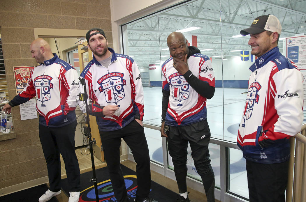 In this Jan. 3, 2019 photo, former Minnesota Vikings football player Jared Allen, second from left, stands with his three curling teammates, from left, Michael Roos, Keith Bullock and Marc Bulger ...