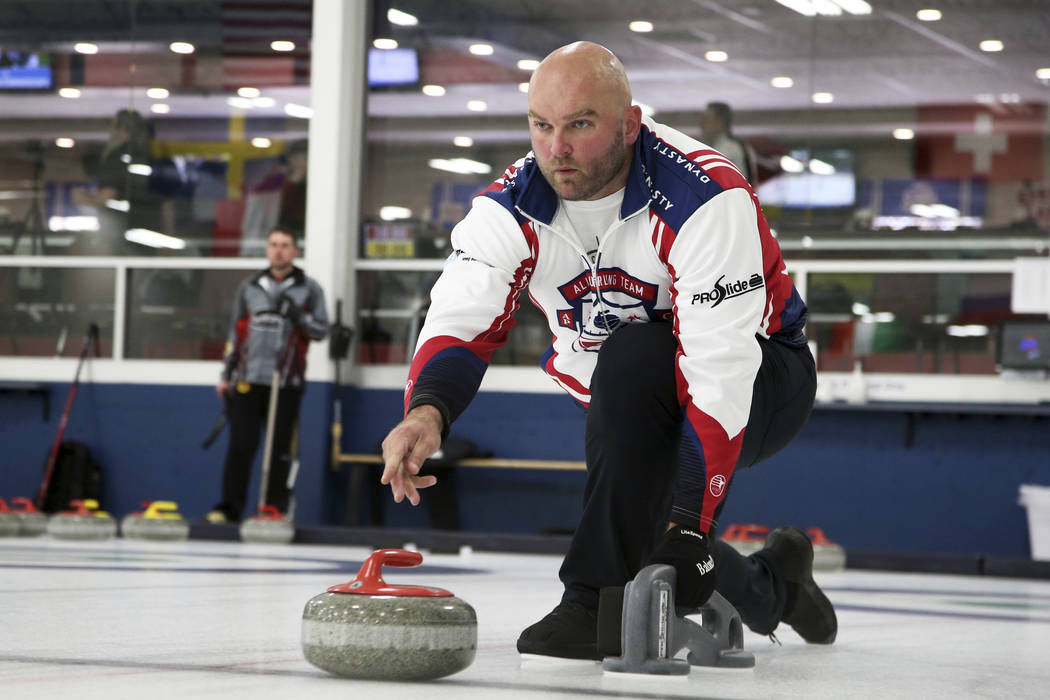 In this Jan. 3, 2019 photo, former NFL offensive lineman Michael Roos practices with his curling team for a competition in Blaine, Minn. Roos and three other former NFL football players who have n ...