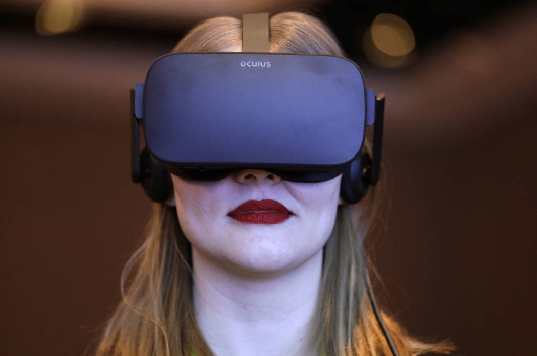A woman participates in a virtual realty presentation during an Intel news conference before CES International in Las Vegas on Jan. 4, 2017. The weeklong event is one of the world's largest trad ...