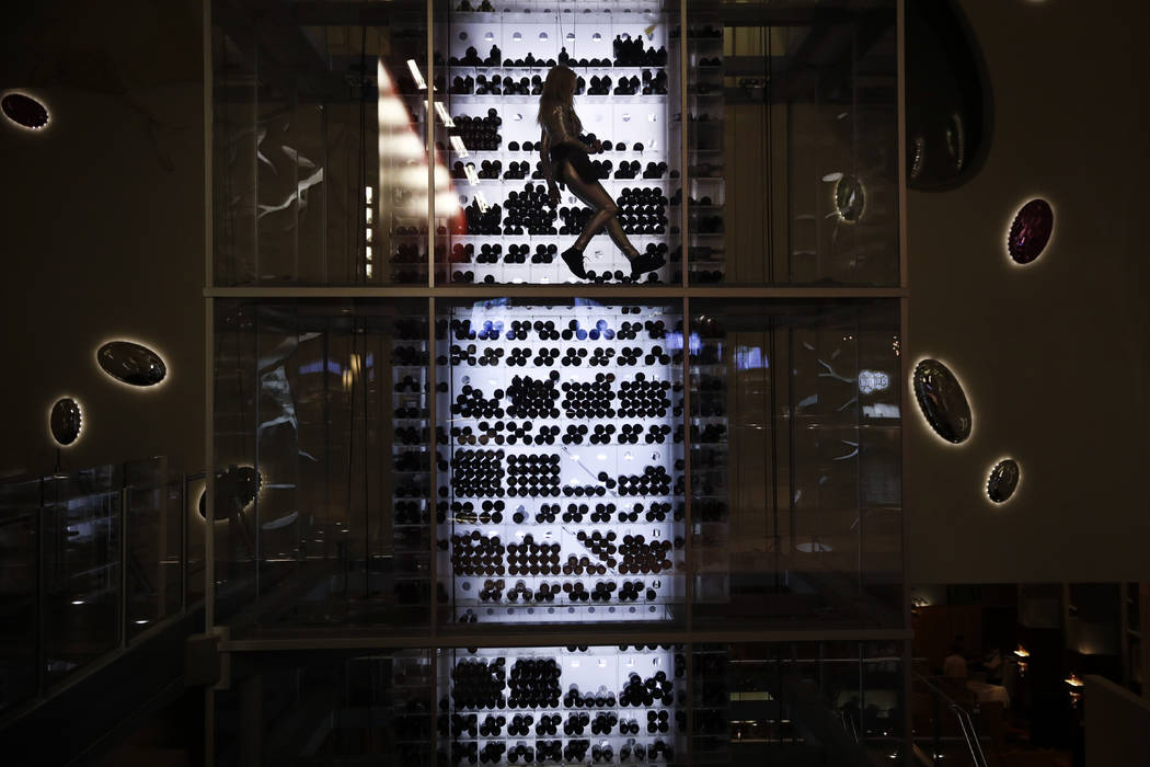 Aureole's wine angel rappels up the wind tower at the Mandalay Bay hotel and casino during CES International in Las Vegas on Jan. 7, 2018. The weeklong event is one of the world's largest trade ...
