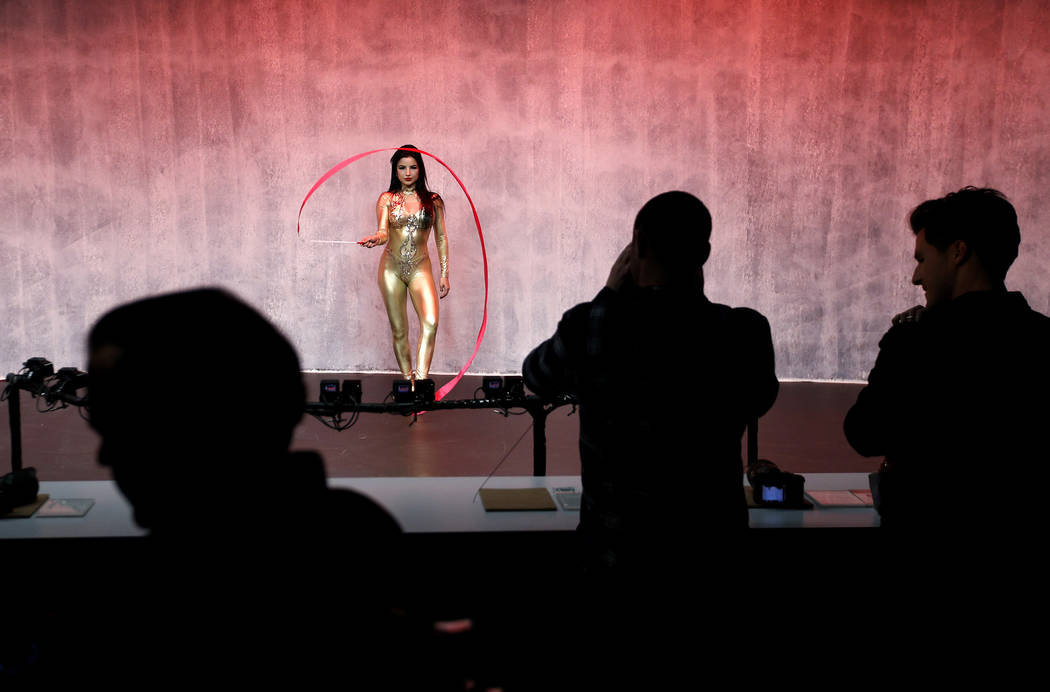 A model performs at a display for Sony cameras after a Sony news conference at CES International in Las Vegas on Jan. 8, 2018. Critics have been on the case of one of the tech industry's larges ...