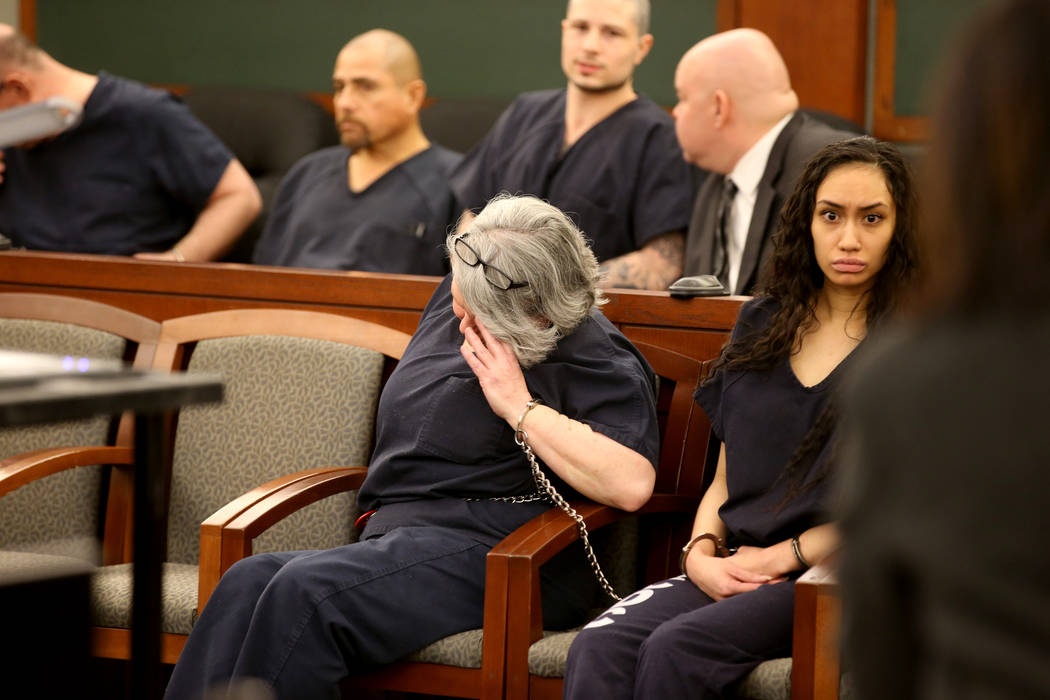 Former Nevada guardian April Parks hides her face before being sentenced at the Regional Justice Center in Las Vegas Friday, Jan. 4, 2019, after pleading guilty to exploitation, theft and perjury ...