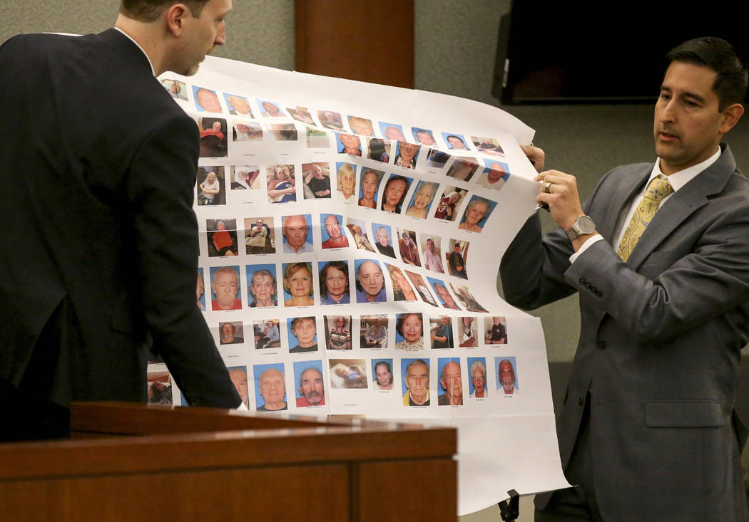 Senior Deputy Attorney General Daniel Westmeyer, left, and Chief Deputy District Attorney set up a display before sentencing for former Nevada guardian April Parks at the Regional Justice Center i ...