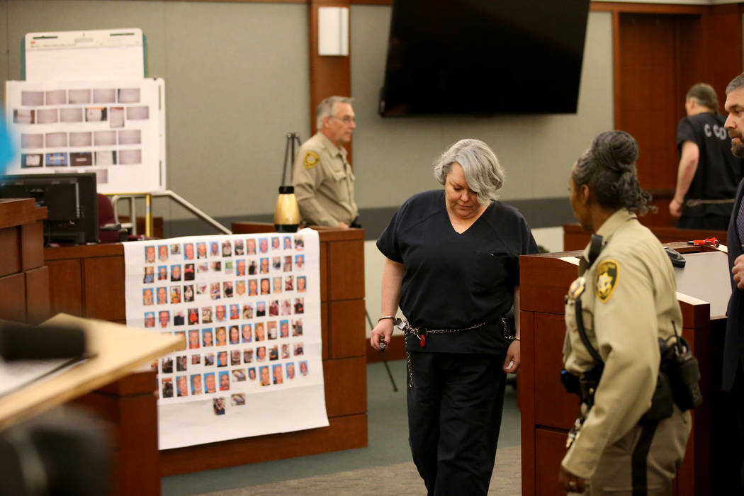 Former Nevada guardian April Parks is escorted out of the courtroom during a break in her sentencing at the Regional Justice Center in Las Vegas Friday, Jan. 4, 2019, after pleading guilty to expl ...