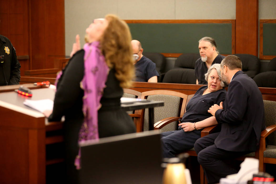 Former Nevada guardian April Parks talks to her attorney Anthony Goldstein as Elizabeth Indig gives a victim statement during Parks' sentencing at the Regional Justice Center in Las Vegas Friday, ...