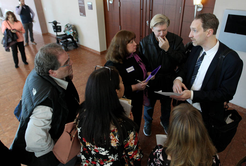 Senior Deputy Attorney General Daniel Westmeyer, right, talks to victims after sentencing for former Nevada guardian April Parks at the Regional Justice Center in Las Vegas Friday, Jan. 4, 2019. K ...