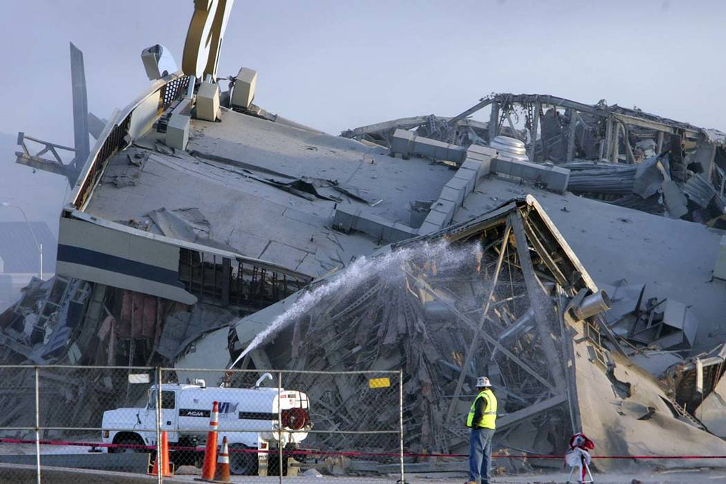Water is shot onto the remains of the Castaways Hotel and Casino to knockdown some of the dust after the casino was imploded earlier in the day Wednesday, Jan. 11, 2006, in Las Vegas. (Gary Thomps ...