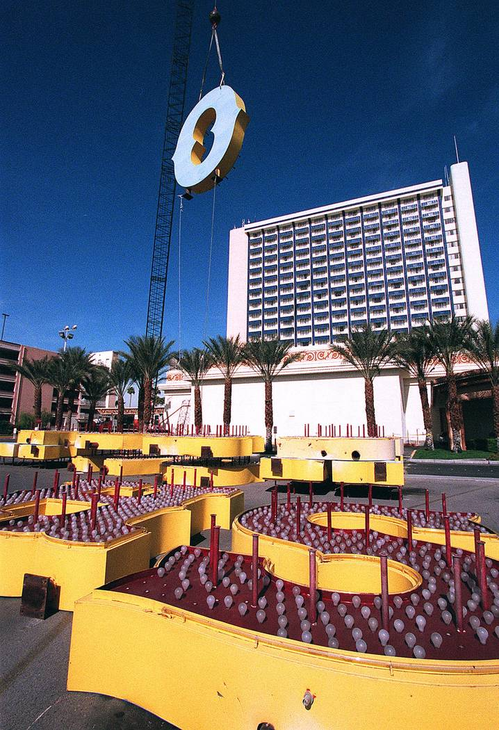 """The letters atop The Showboat are removed to make room for the hotel's new name """"The Castaways"""" on March 20, 2001. The Showboat opened in 1954. (Gary Thompson/Las Vegas Review-Journal)"""