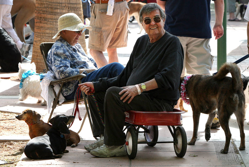 RJ FILE*** MARLENE KARAS/REVIEW JOURNAL Royce Feour, center, finds a seat in a red wagon after walking his dog Rocky during the Las Vegas Valley Humane Society's Wag-A-Tail Walk-A-Thon fundraise ...