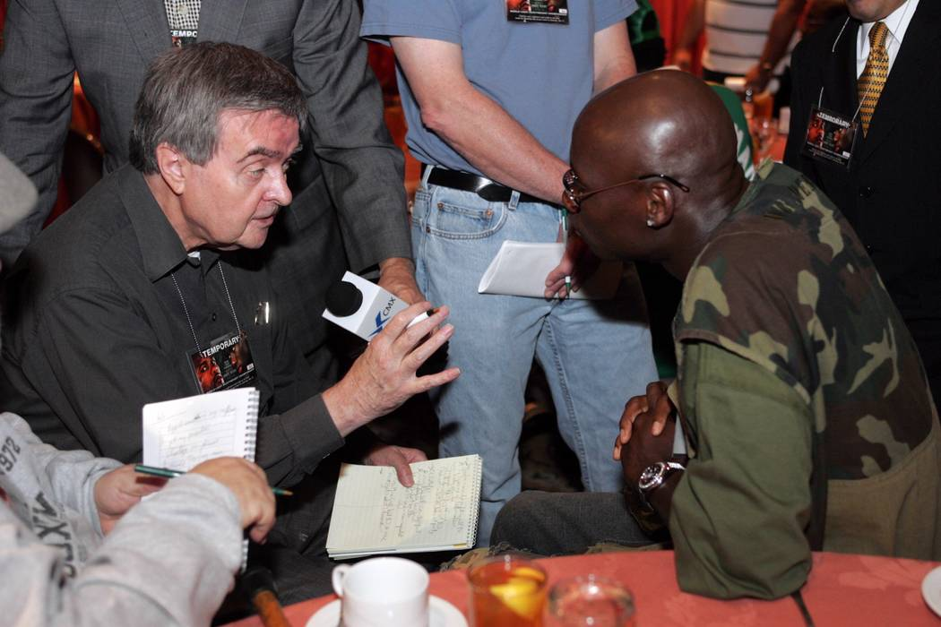 Sports--Legendary boxing writer Royce Feour, left, interviews Antonio Tarver Wednesday, May 12, 2004, before Tarver faced Roy Jones Jr. in their WBC/IBO Light Heavyweight Championship bout at Mand ...