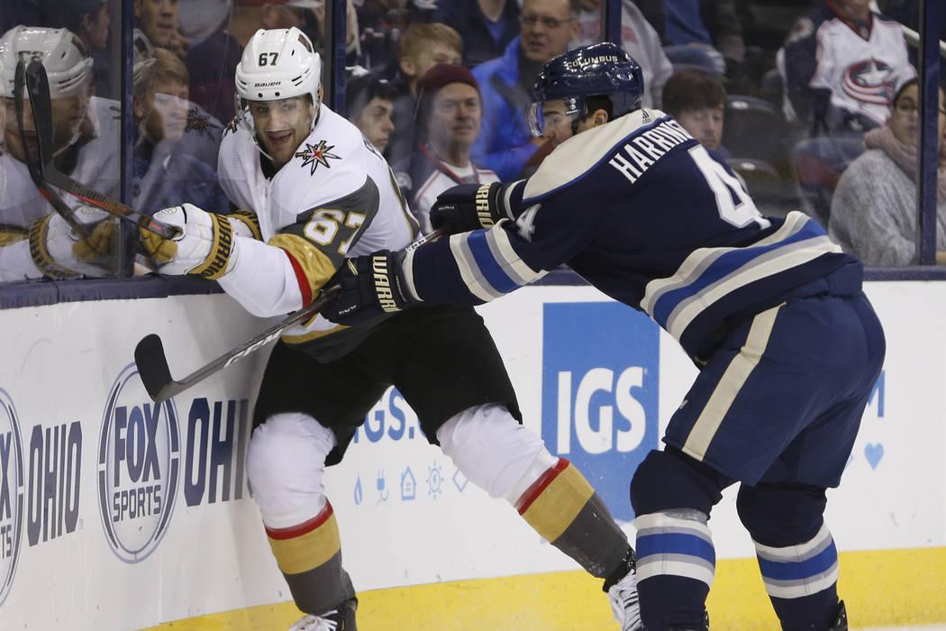 Columbus Blue Jackets' Scott Harrington, right, checks Vegas Golden Knights' Max Pacioretty during the first period of an NHL hockey game Monday, Dec. 17, 2018, in Columbus, Ohio. (AP Photo/Jay La ...
