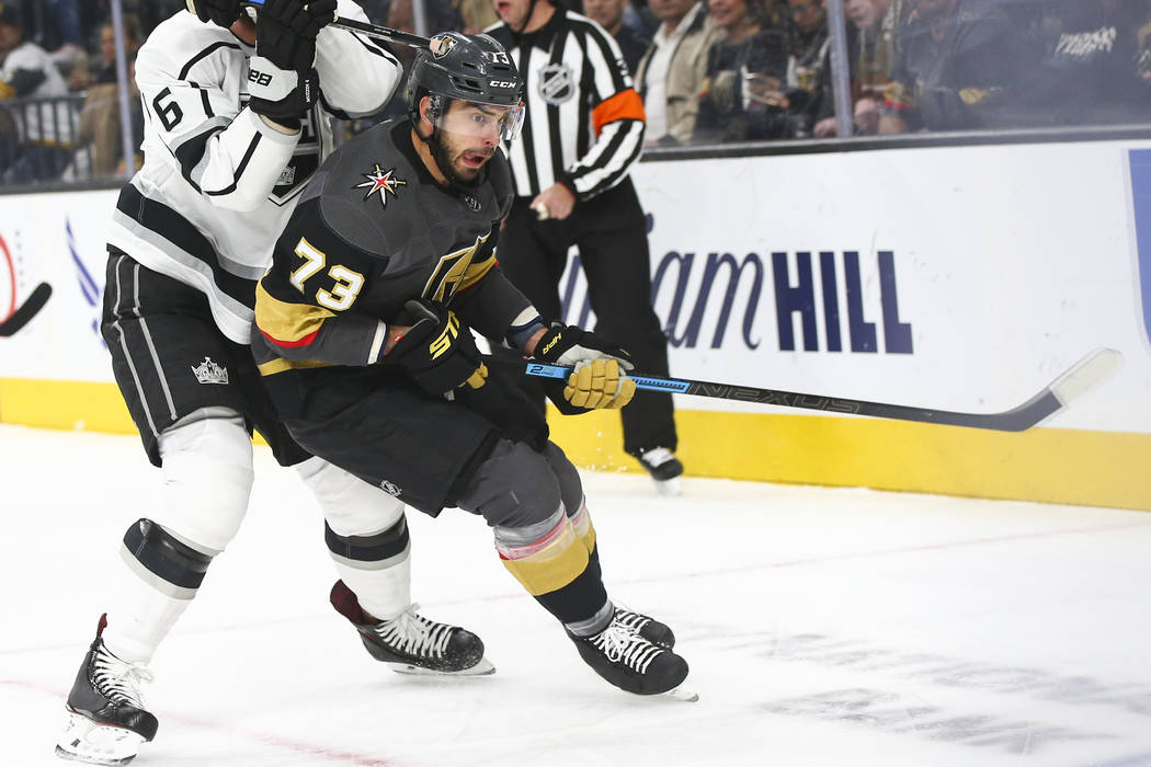 Vegas Golden Knights center Brandon Pirri (73) chases down the puck against Los Angeles Kings defenseman Jake Muzzin (6) during the first period of an NHL hockey game at T-Mobile Arena in Las Vega ...