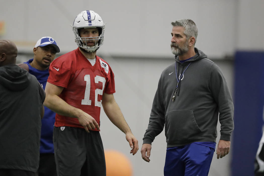 Indianapolis Colts quarterback Andrew Luck (12) talks with head coach Frank Reich during practice at the NFL team's facility, Wednesday, Jan. 2, 2019, in Indianapolis. The Colts will play the Hous ...