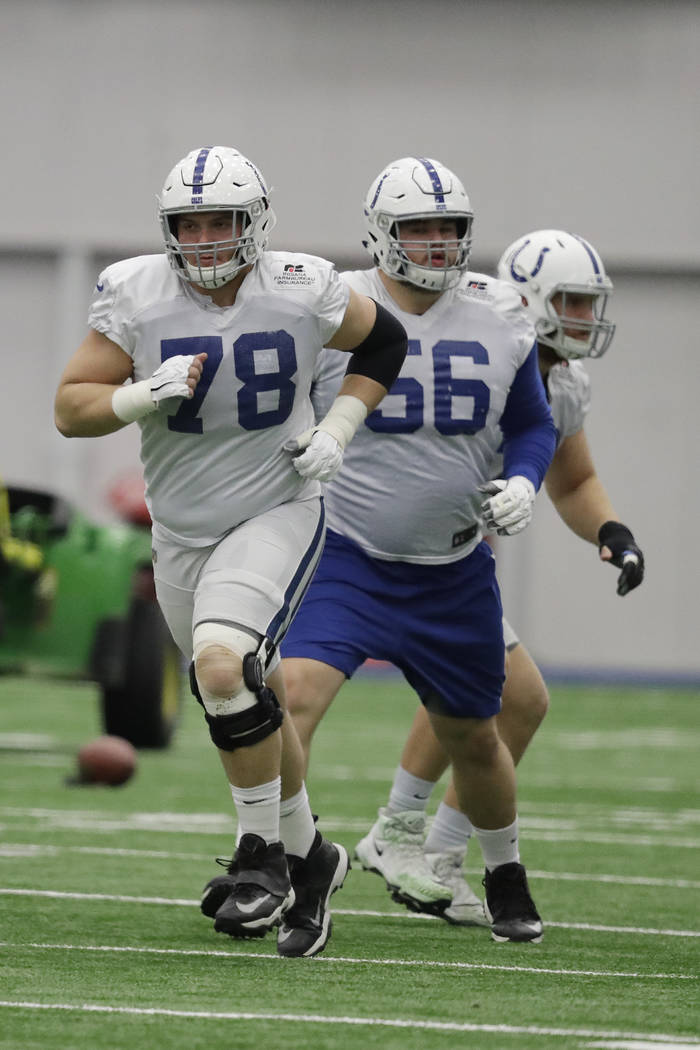 Indianapolis Colts center Ryan Kelly (78) and offensive guard Quenton Nelson (56) run during practice at the NFL team's facility, Wednesday, Jan. 2, 2019, in Indianapolis. The Colts will play the ...