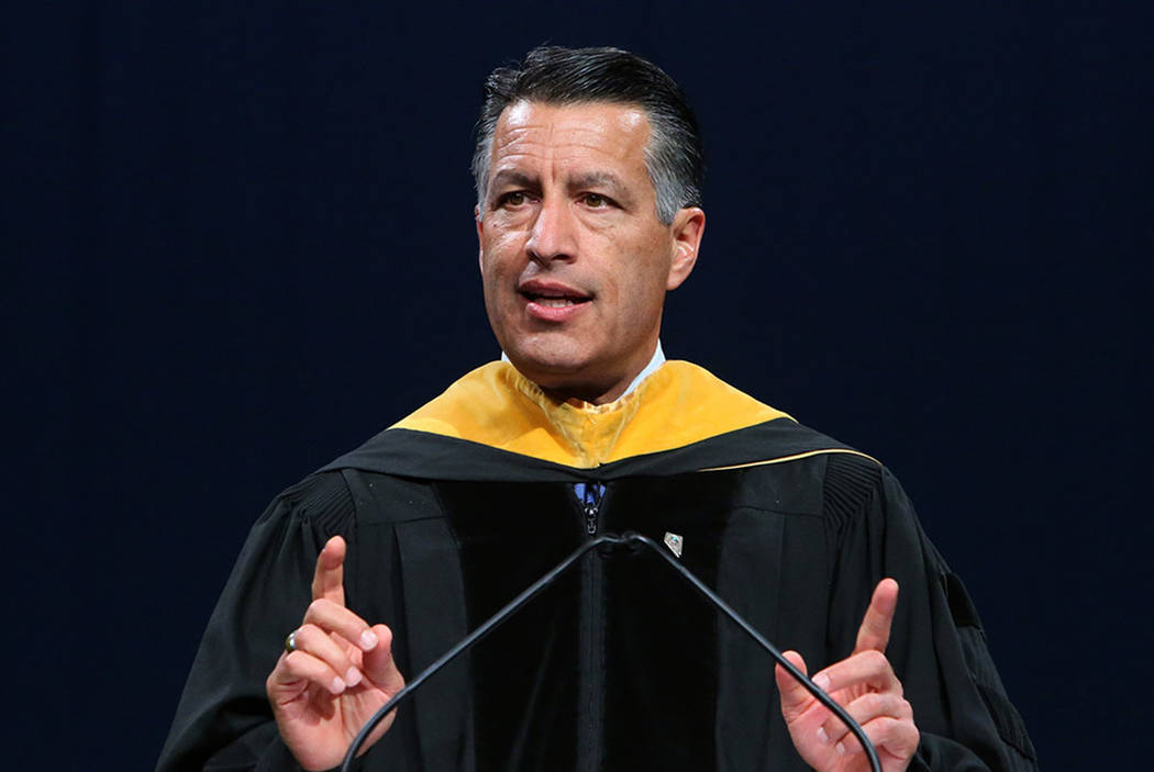 Gov. Brian Sandoval delivers remarks during the master's degree graduation ceremony of Western Governors University of Nevada at the Thomas & Mack Center on Saturday, June 2, 2018, in Las Vega ...
