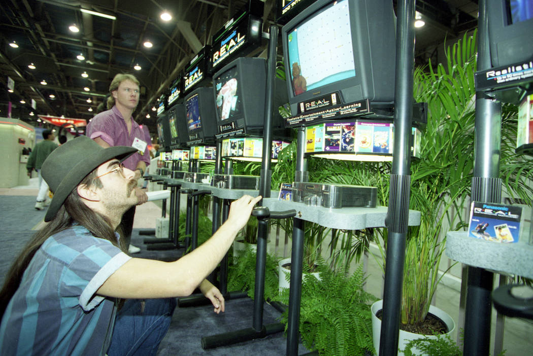 On the last day of the 1994 Consumer Electronics Show, a man plays a Panasonic REAL (Realistic Entertainment Active Learning) game at the Las Vegas Convention Center. (John Gurzinski/Las Vegas Rev ...