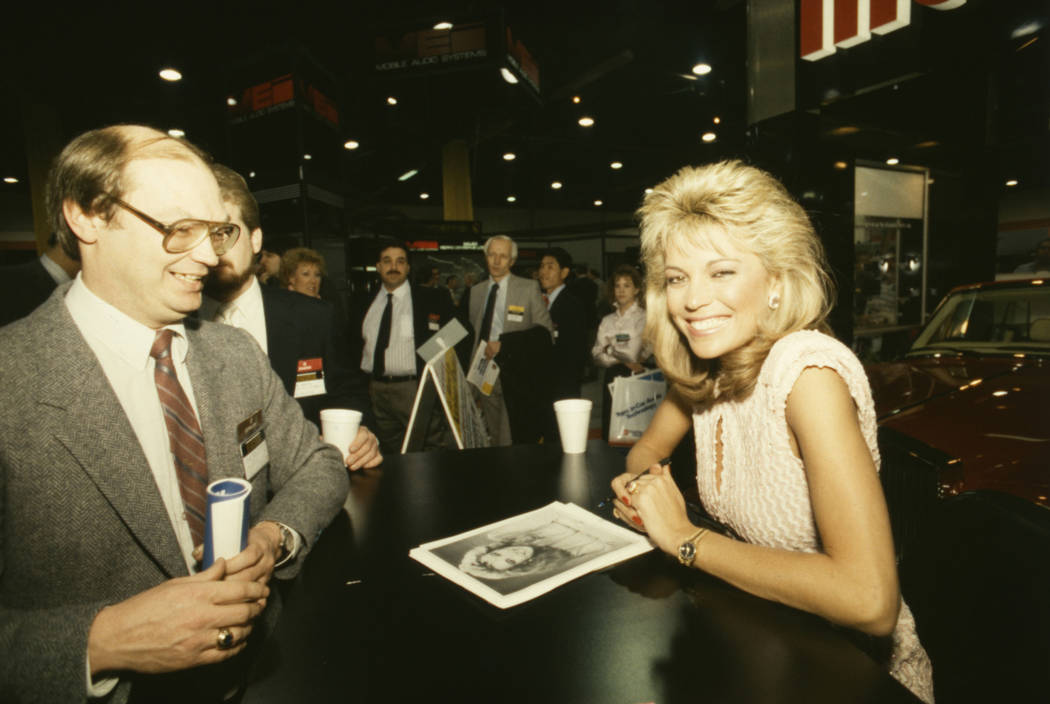 """""""Wheel of Fortune"""" co-star Vanna White signs autographs for fans at the 1987 Consumer Electronics Show at the Las Vegas Convention Center. White was the main attraction at a MaxiGuard car security ..."""